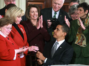 President Barack Obama signs the Lily Ledbetter Fair Pay Act.