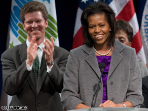 Hosted by Housing Secretary Shaun Donovan, background, the first lady was warmly greeted at HUD Wednesday.
