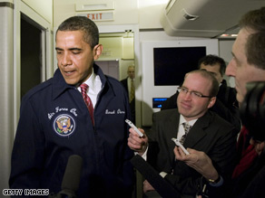 Donning a blue jacket with the presidential seal on the right and his name embroidered on the left, President Obama came back to the press section of the plane shortly before taking off for a trip to Williamsburg, Virginia. 