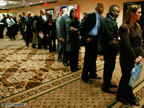 Job seekers stand in line at a job fair in Virginia.