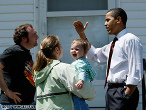 Then-Sen. Obama spoke with Sam and Dannielle Ericson while canvassing for votes in Elkhart, Indiana last May. Obama returns to the town as president today.
