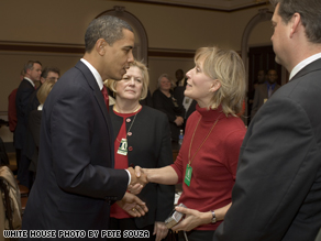 President Barack Obama shakes hands with Beverly Eckert on Feb. 6, 2009, during a  meeting in Washington, D.C., at the Eisenhower Executive Office Building with a group who lost family members in the 9/11 and the U.S.S. Cole tragedies.