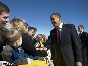 The President greeted supporters at an Air Force base near Denver, Colorado Tuesday before signing the $787 billion stimulus bill.