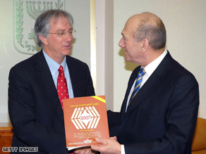 Israeli Prime Minister Ehud Olmert receives the Jewish People Policy Planning Institute's report from Dennis Ross on January 6, 2008 in Jerusalem.