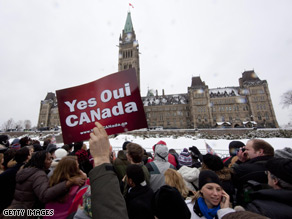 "Chants of ""Yes we can! Yes we can!"" could be heard as thousands of Canadians lined the streets to greet Obama's motorcade."