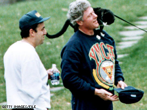 Bill Clinton enjoys pet cat Socks in this 1993 file photo.