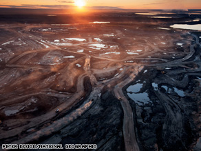 Dust hangs in the sunset sky above the Suncor Millennium mine, an open-pit north of Fort McMurray, Alberta.