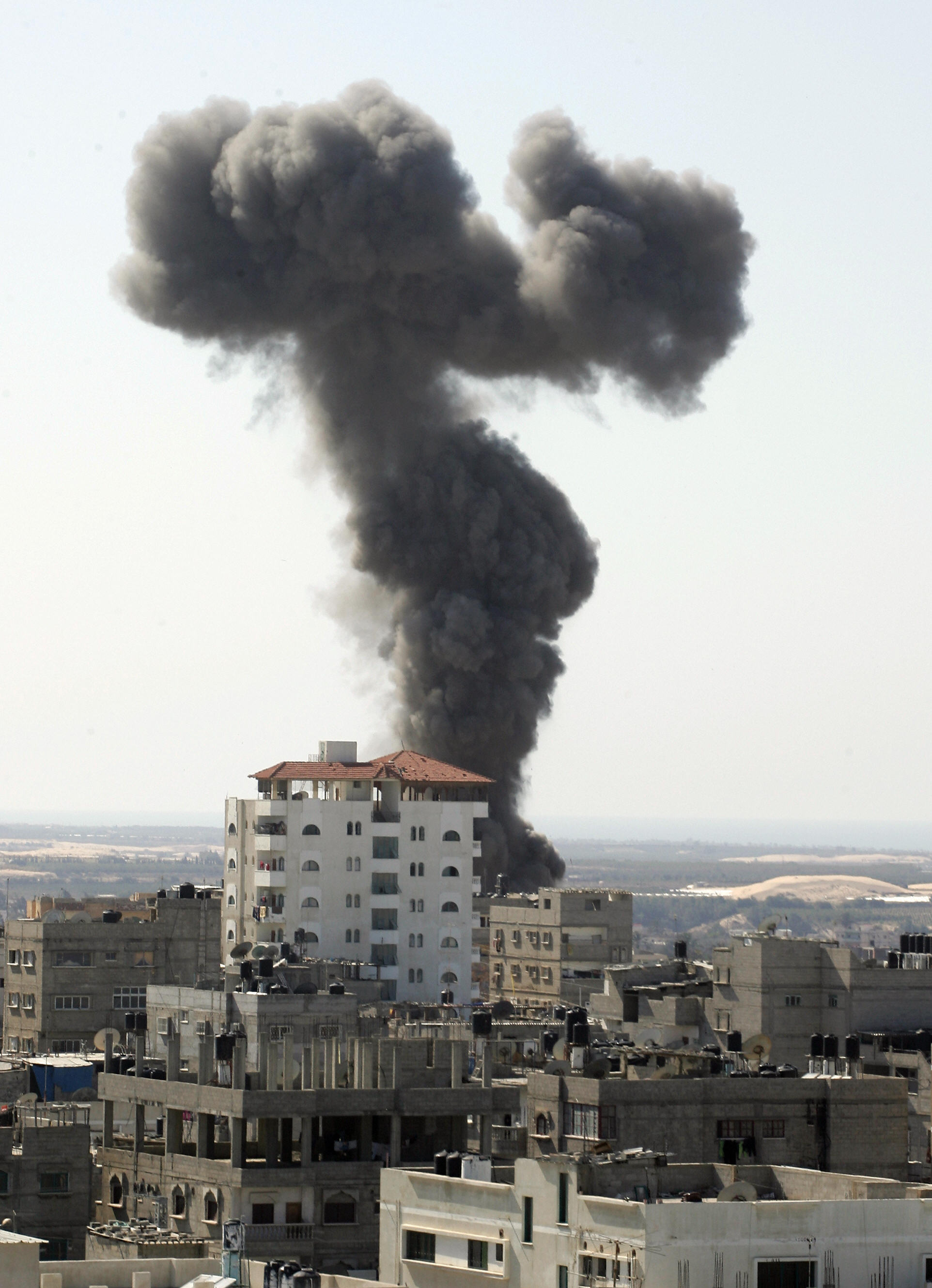 SAID KHATIB/AFP/Getty Images. Israeli warplanes launched two air strikes along the Gaza Strip's border with Egypt as delegates from three Palestinian factions were crossing at a nearby terminal, witnesses said.