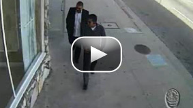 Watch surveillance video from the LAPD right before the two men commit armed robbery.