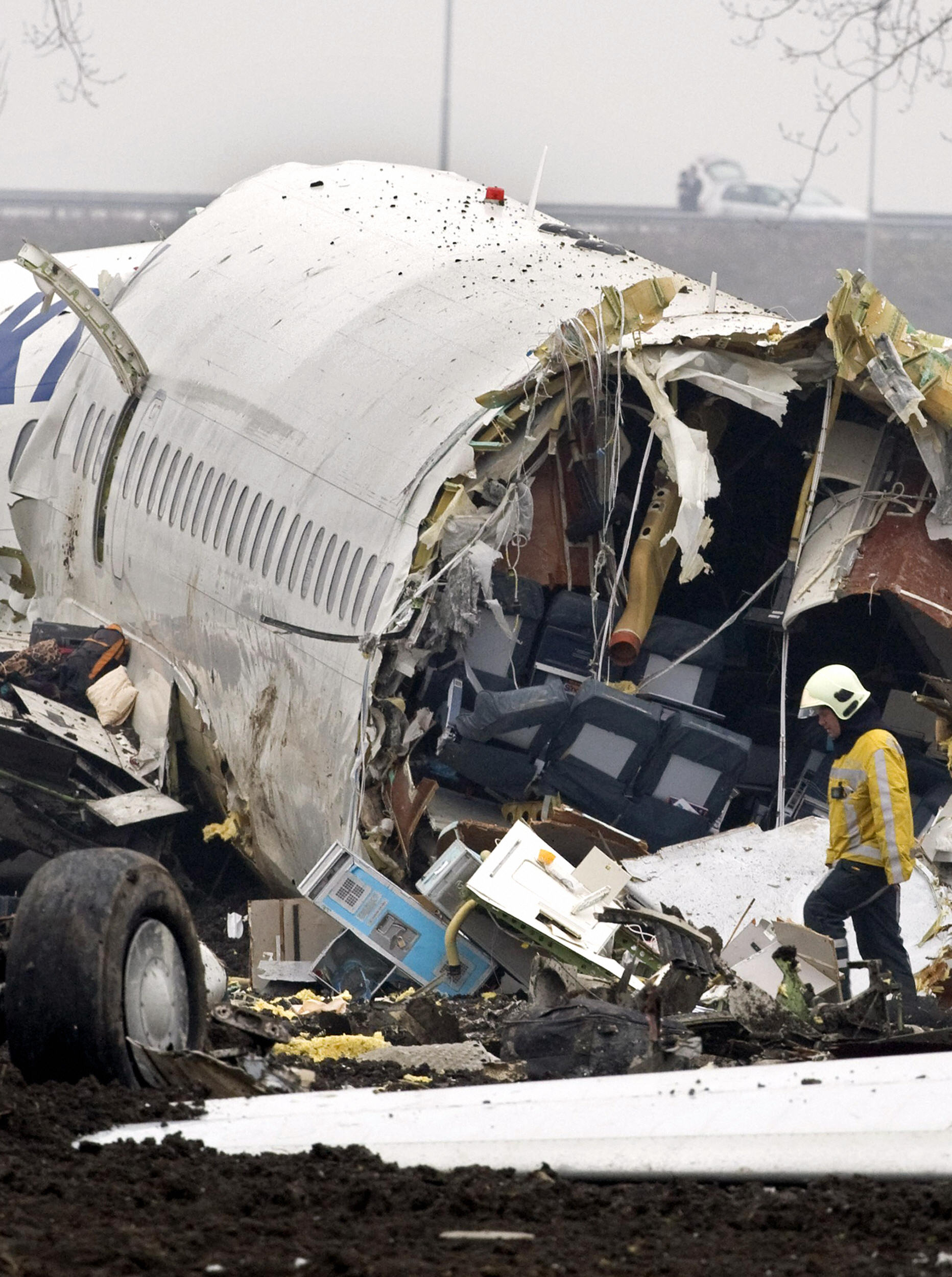 MARCEL ANTONISSE/AFP/Getty Images. Emergency services work at the scene of the Turkish Airlines passenger plane which crashed on February 25, 2009 while landing at Schiphol airport in Amsterdam.