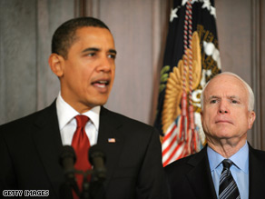 With former presidential rival Sen. John McCain and other congressional critics of government waste by his side, President Barack Obama changed another Bush-era policy Wednesday.