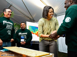 Michelle Obama met with members of YouthBuild Tuesday on the National Mall in Washington, DC.