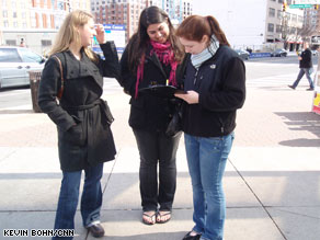 Three women signed petitions Saturday outside a Virginia subway station as part of the push by Organizing for America, a Democratic organization of the president&#039;s grassroots supporters.