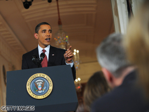 President Barack Obama answers questions during a prime time news conference.