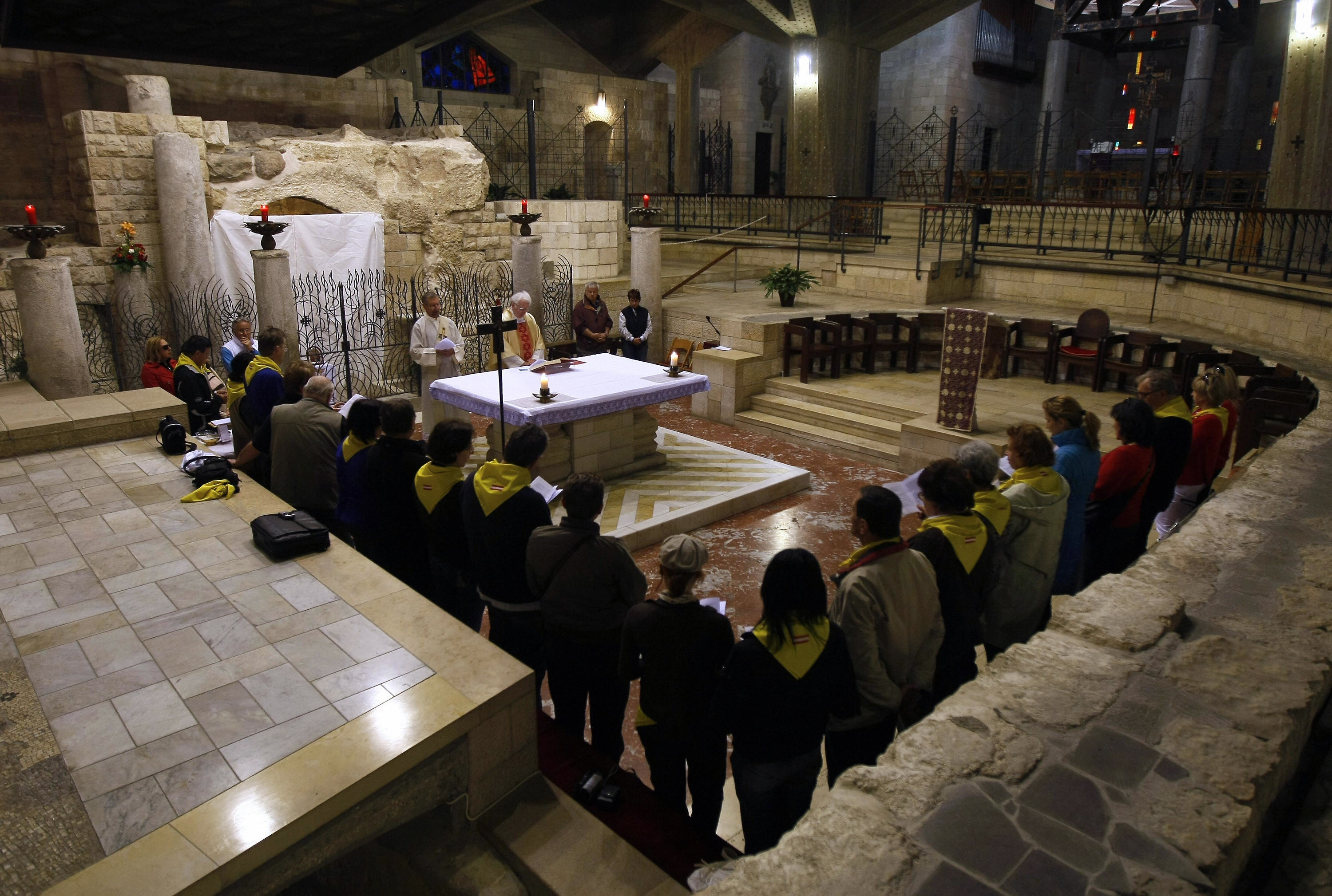 MENAHEM KAHANA/AFP/Getty Images. Christian pilgrims attend Sunday mass at the grotto of the Church of the Annunciation.