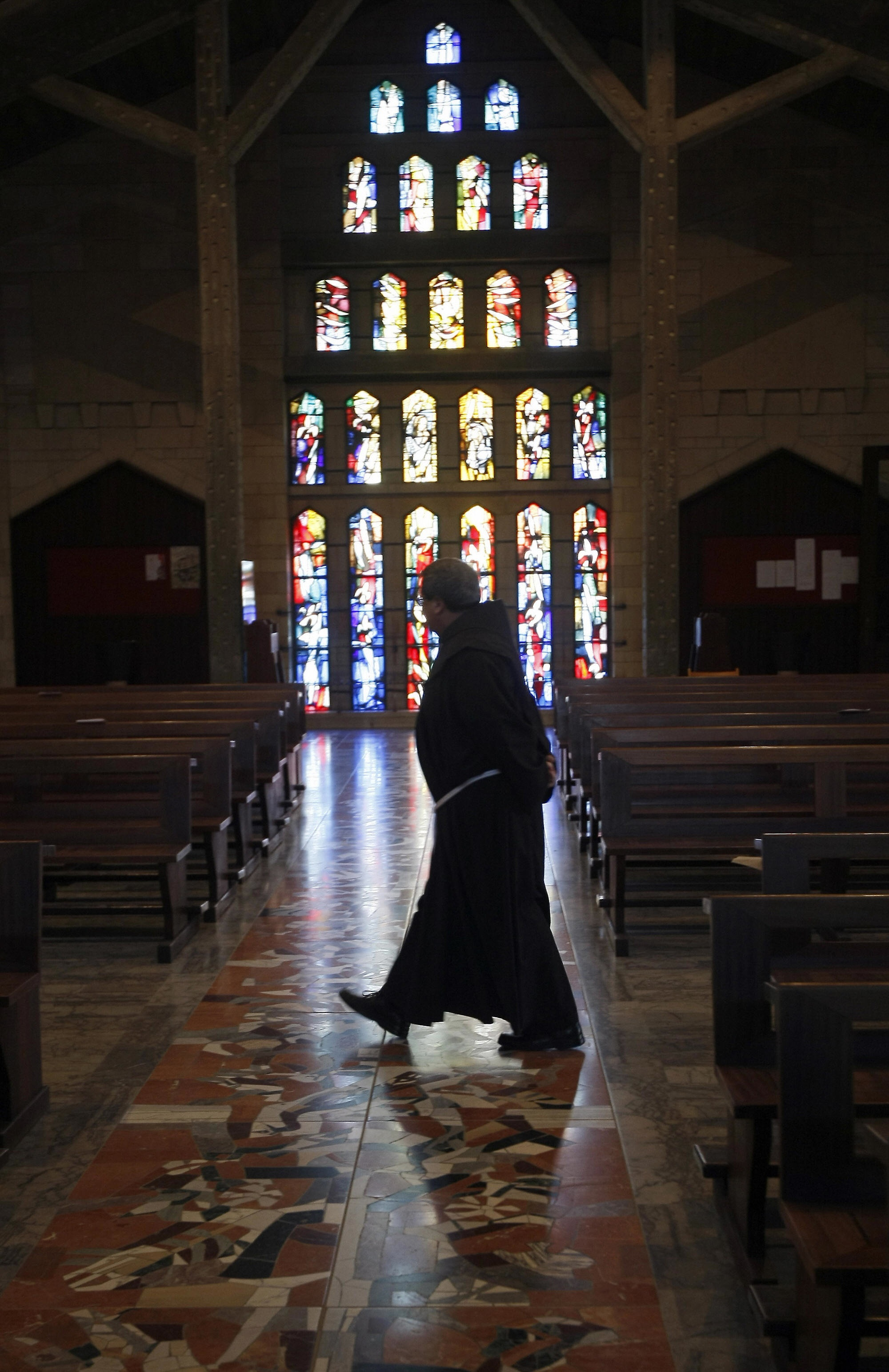 MENAHEM KAHANA/AFP/Getty Images.A priest walks at the Church of the Annunciation, believed to stand at the site of Mary's house where angel Gabriel appeared and announced that she would give birth to Jesus Christ, in the outskirts of the Galilee town of Nazareth in northern Israel on March 29, 2009. Pope Benedict XVI is scheduled to hold an open-air mass near the site during his visit to the Holy Land in May.