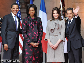 President Barack Obama and First Lady Michelle Obama are welcomed by French First Lady Carla Bruni-Sarkozy and French President Nicolas Sarkozy