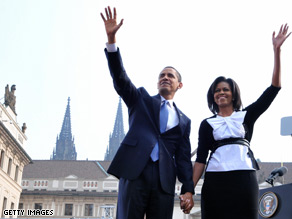 Americans gave first lady Michelle Obama high marks following the first couples' debut overseas.
