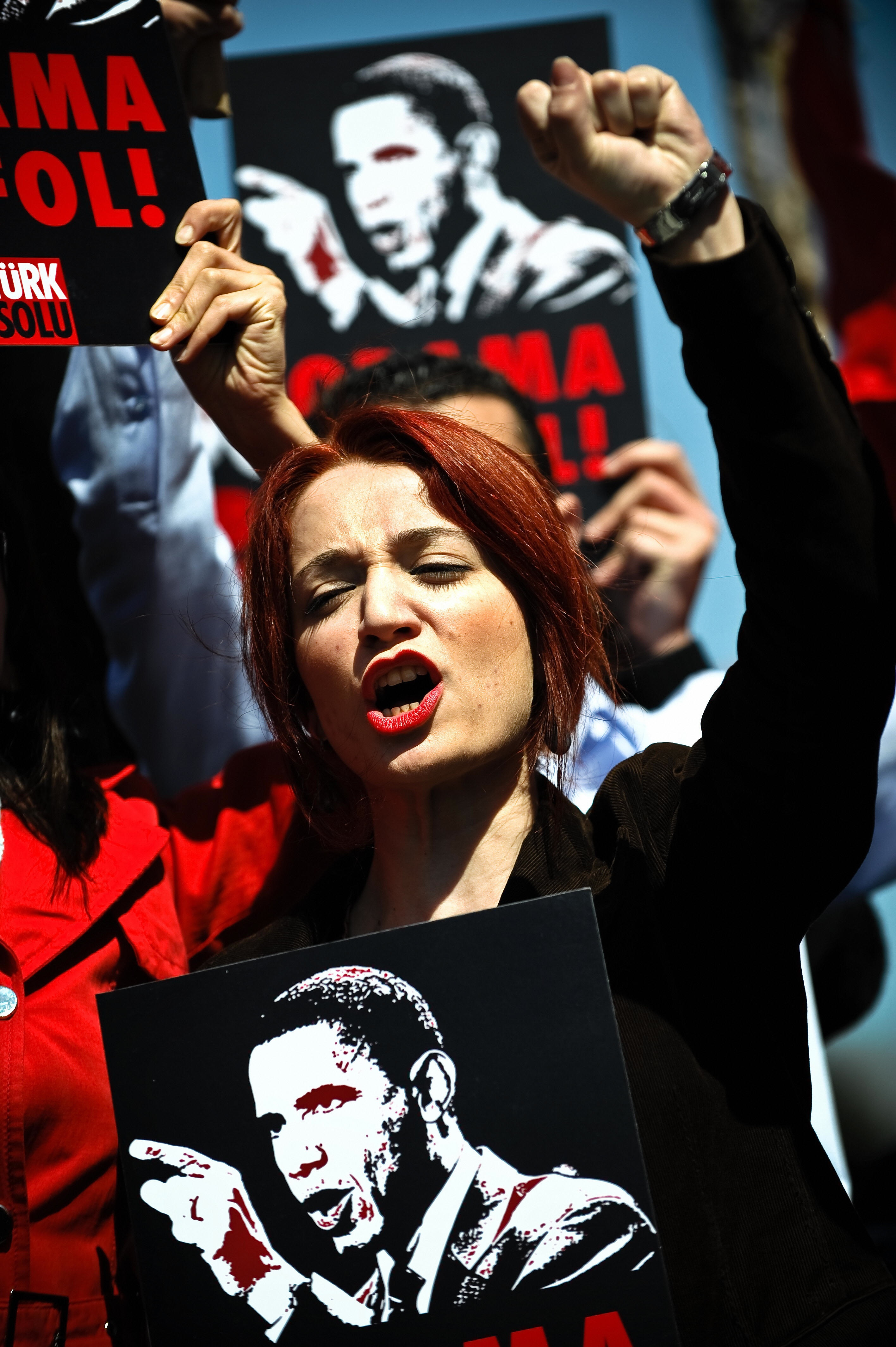 DIMITAR DILKOFF/AFP/Getty Images. A Turkish protestor shouts slogans and holds a banner reading 'Obama go home' during a demonstration against upcoming visit of US President Barack Obama in Istanbul on April 5, 2009.