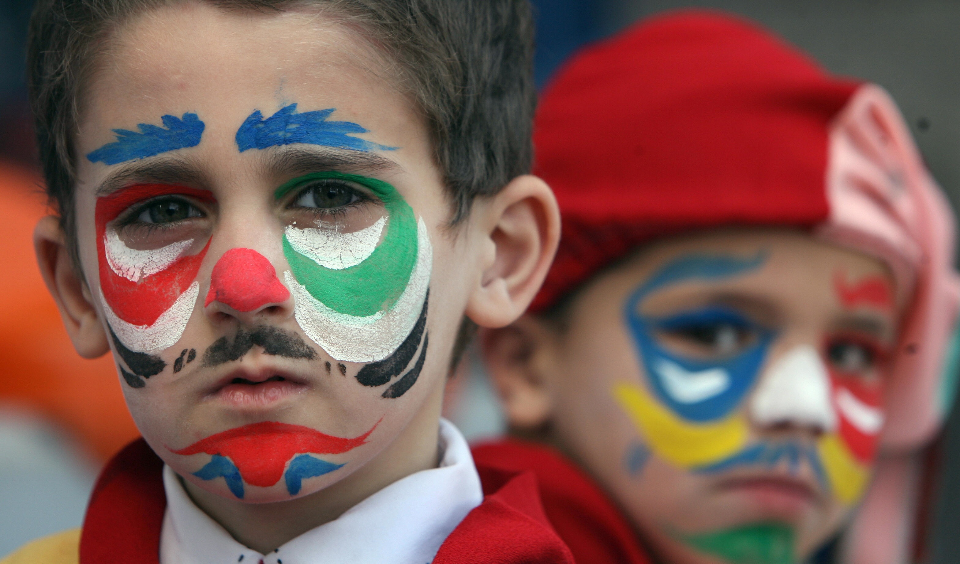 MAHMUD HAMS/AFP/Getty Images.Palestinian children attend a rally in Gaza City to mark the Palestinian children day on April 05, 2009.