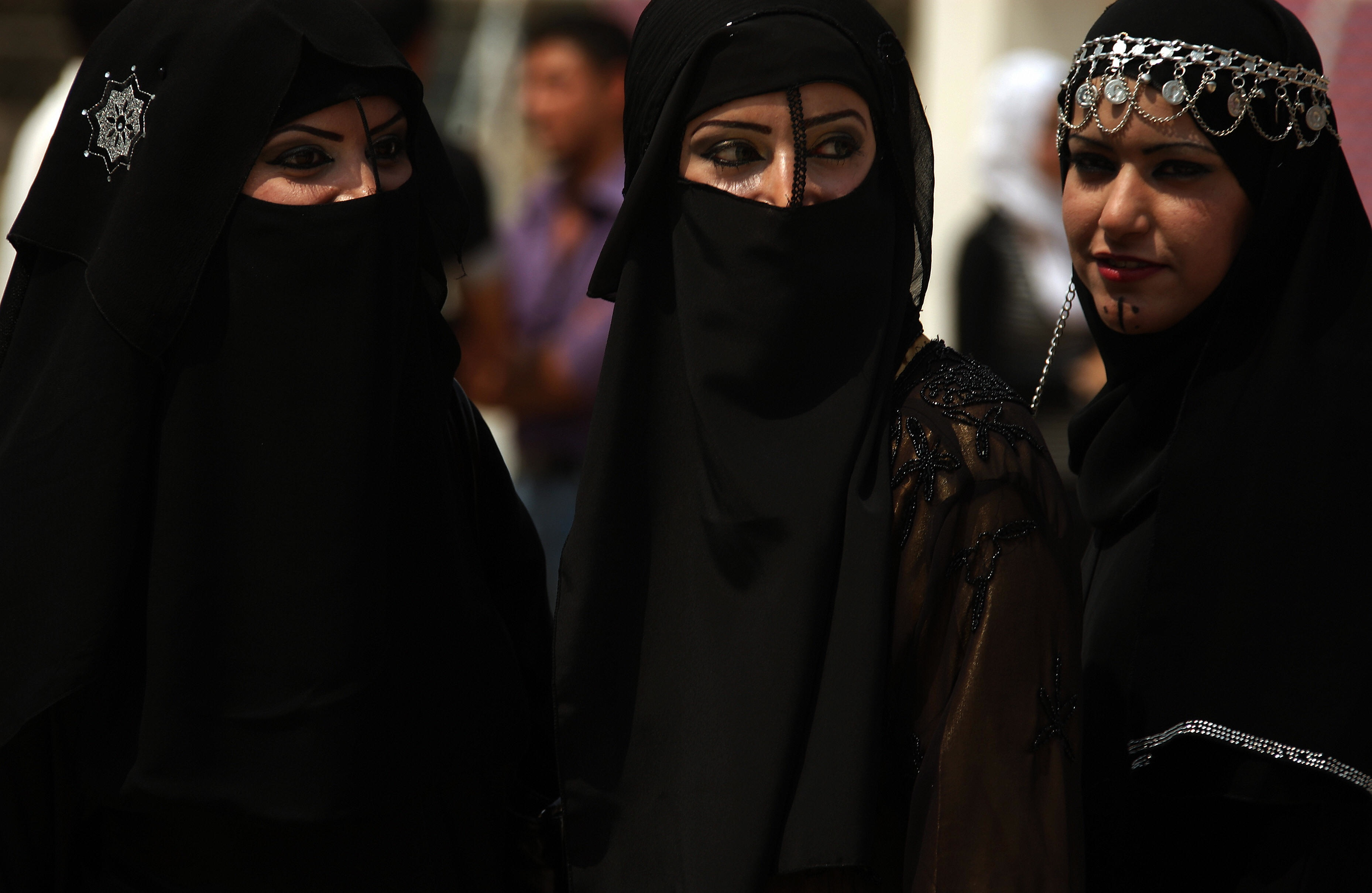 PATRICK BAZ/AFP/Getty Images. Iraqi female students wearing Arab folkloric dresses and Bedouin masks take part in a graduation party at the Baghdad IT and Technology University as they celebrate on April 06, 2009.