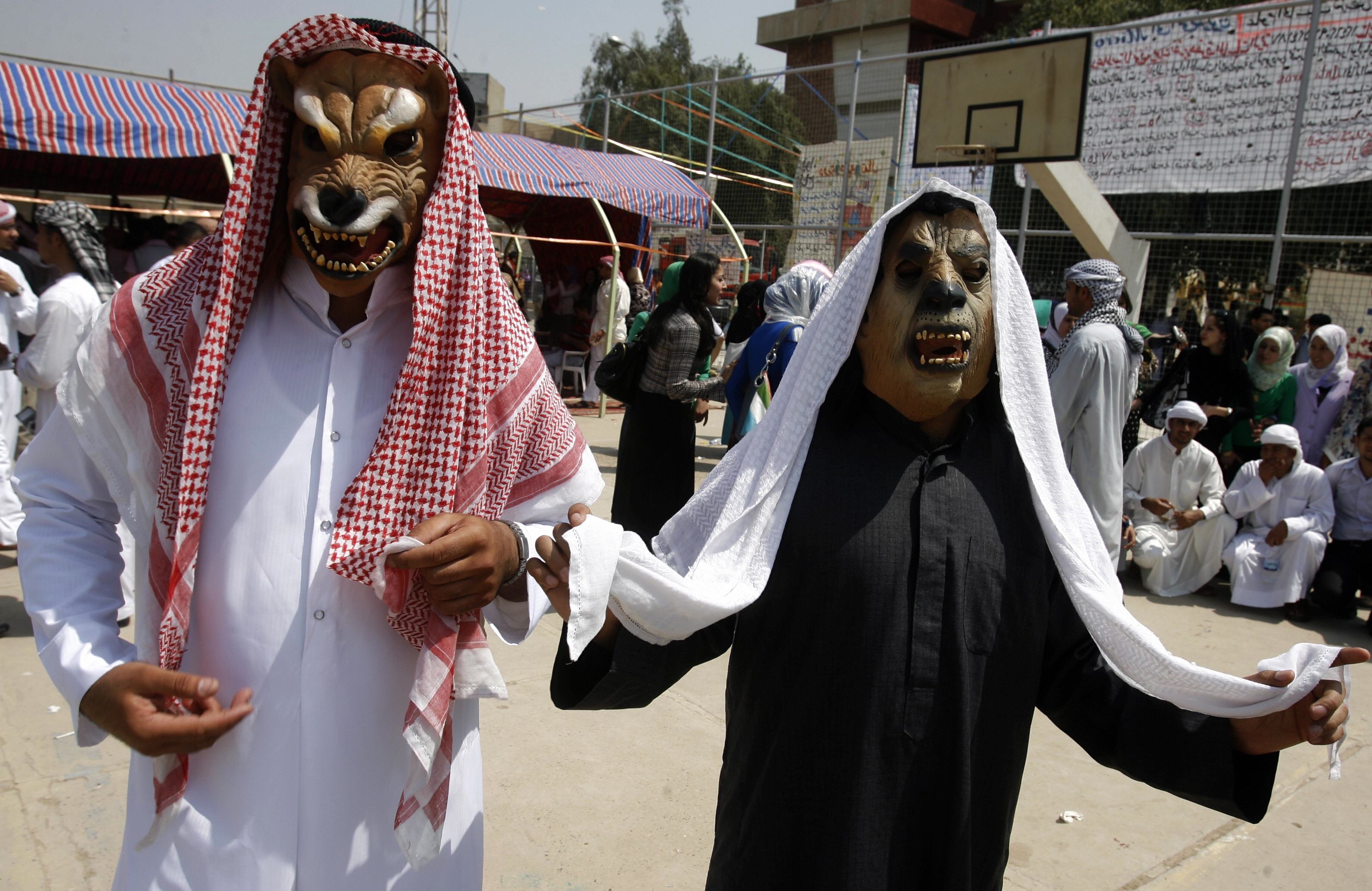 ATRICK BAZ/AFP/Getty Images. Iraqi students wearing masks take part in a graduation party at the Baghdad IT and Technology University as they celebrate on April 06, 2009.