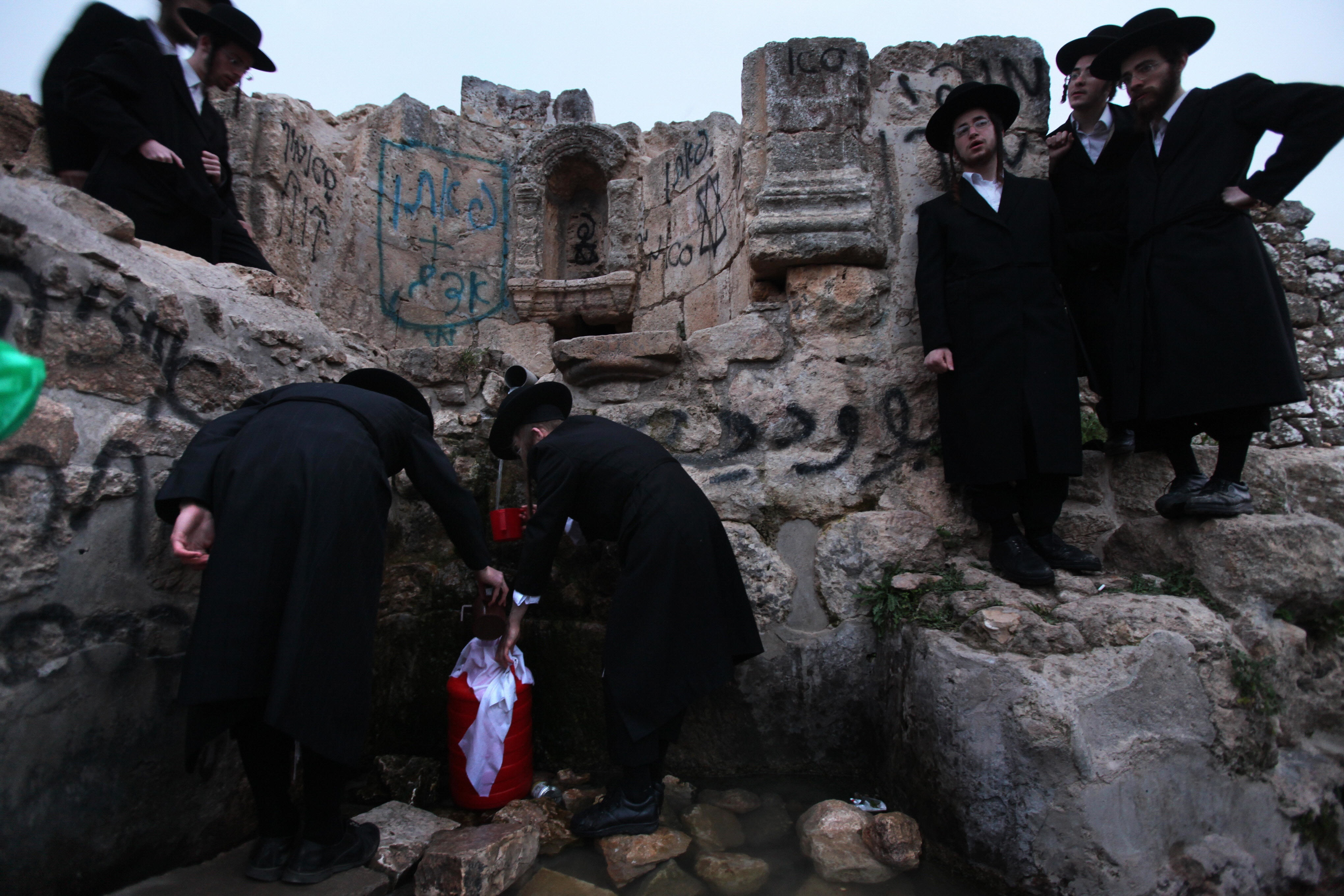 MENAHEM KAHANA/AFP/Getty Images. Ultra-Orthodox Jews fill their plastic containers with water from an ancient mountain spring near Jerusalem on April 6, 2009 during the Maim Shelanu (rested water) ceremony in preparation for the Pesach holiday (Passover). The water is used in baking the unleavened bread, known in Hebrew as Matzoh, which religious Jews throughout the world eat during the eight-day holiday. This year, Passover --commemorating the Israelites' exodus from Egypt some 3,500 years ago -- will begin at sunset on April 8.