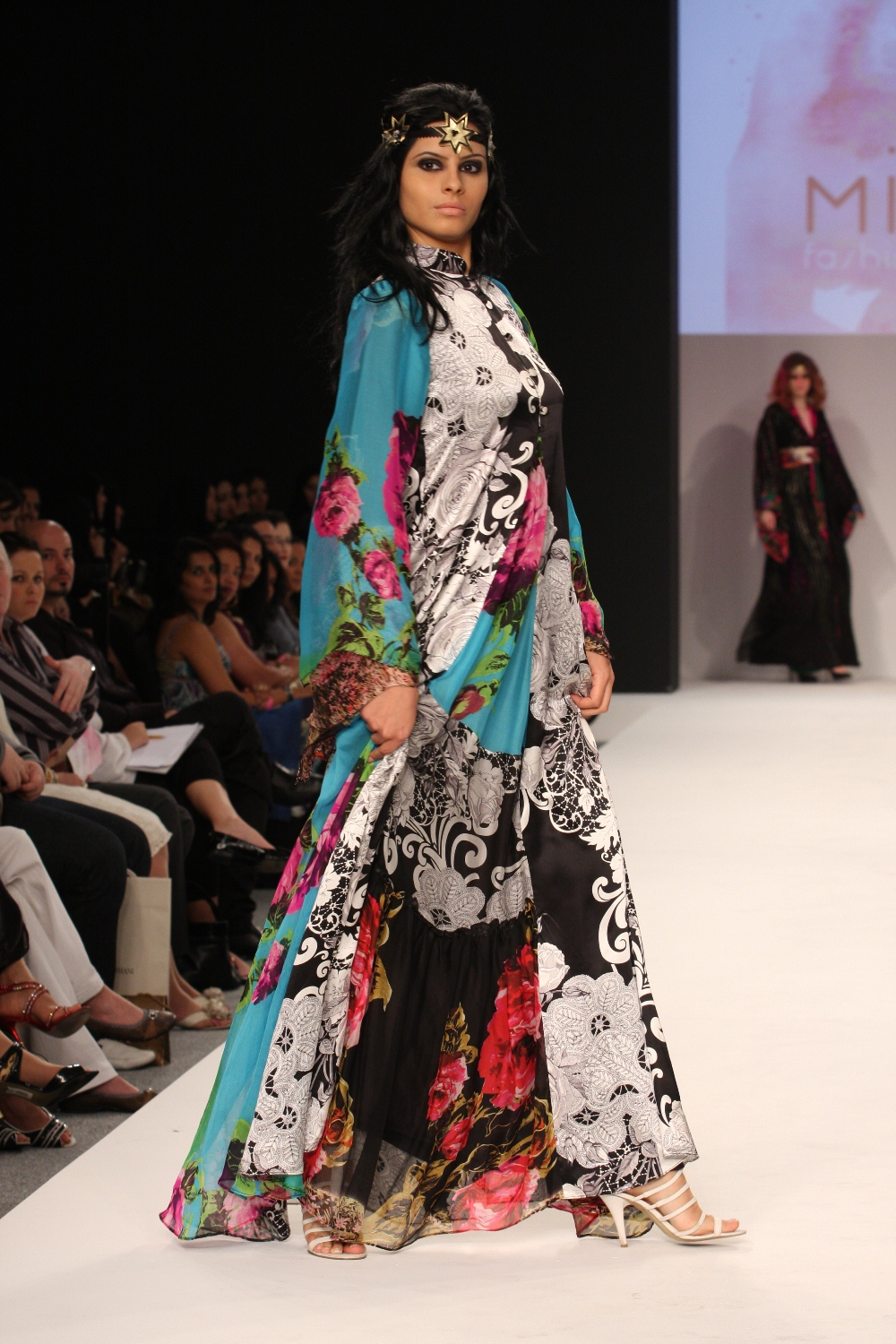 Mariam Al Mazro shifted the focus of Dubai Fashion Week A/W 09 to prints. Flamboyancy mixed with a carefree attitude was represented in her collection of panelled ankle-length dresses.