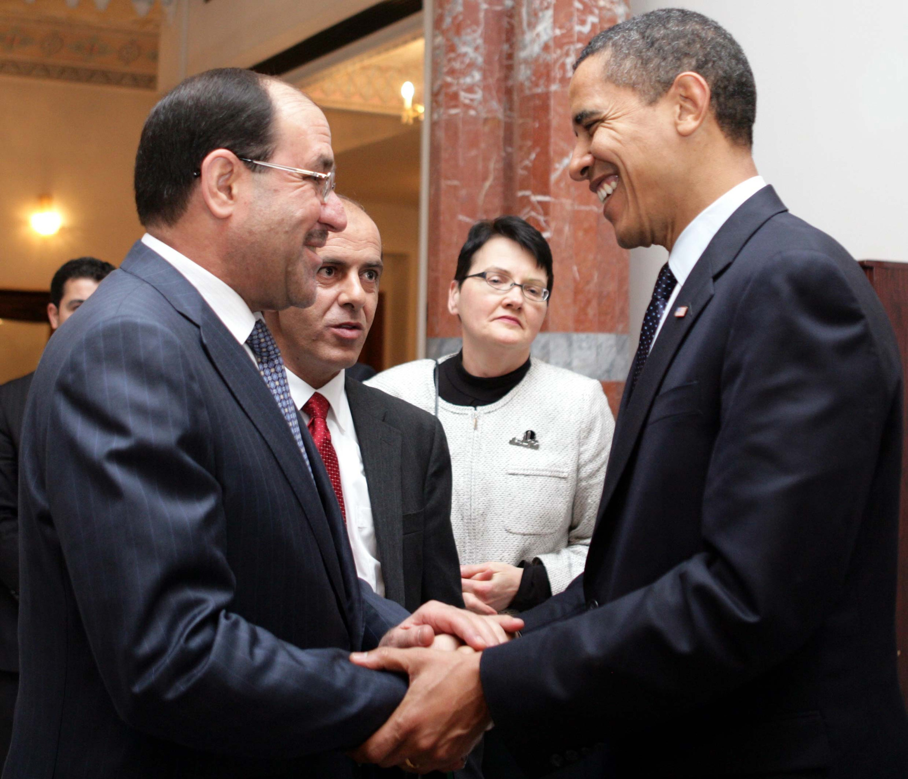 Iraqi Prime Minister office via Getty Images. Iraqi Prime Minister Nuri al-Maliki (L) shakes hands with U.S. President Barack Obama (R) on April 7, 2009 in Baghdad, Iraq. Obama made a surprise visit to Iraq and spoke about the transition of power to the Iraqi government.