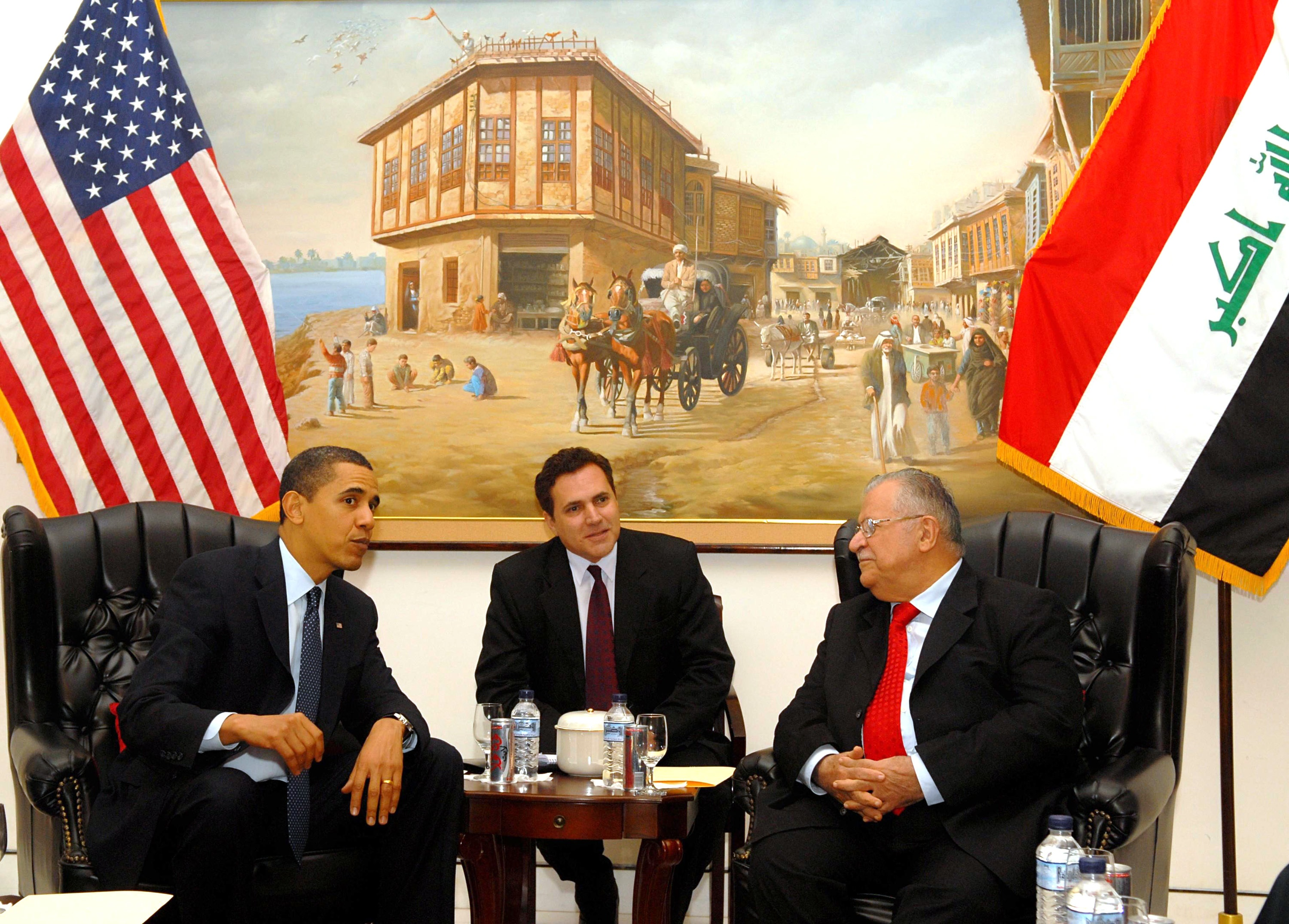 Iraqi President's Office via Getty Images. Iraqi President Jalal Talabani (R) speaks with U.S. President Barack Obama (L) as an interpreter sits (C) April 7, 2009 in Baghdad, Iraq. Obama made a surprise visit to Iraq and spoke about the transition of power to the Iraqi government.