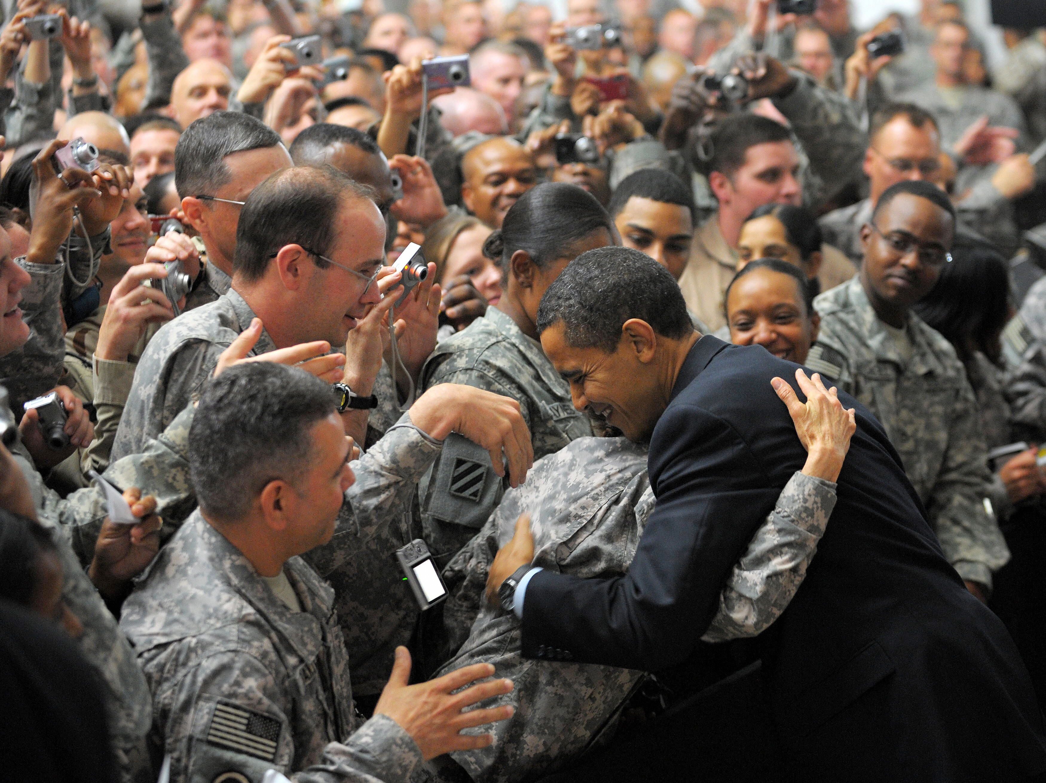 MANDEL NGAN/AFP/Getty Images. US President Barack Obama (R) greets troops during a visit to Camp Victory, just outside Baghdad, on April 7, 2009.