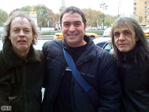Rick Saleeby yelped upon seeing a camera, and asked us to use this photo of him with favorite band AC/DC instead.