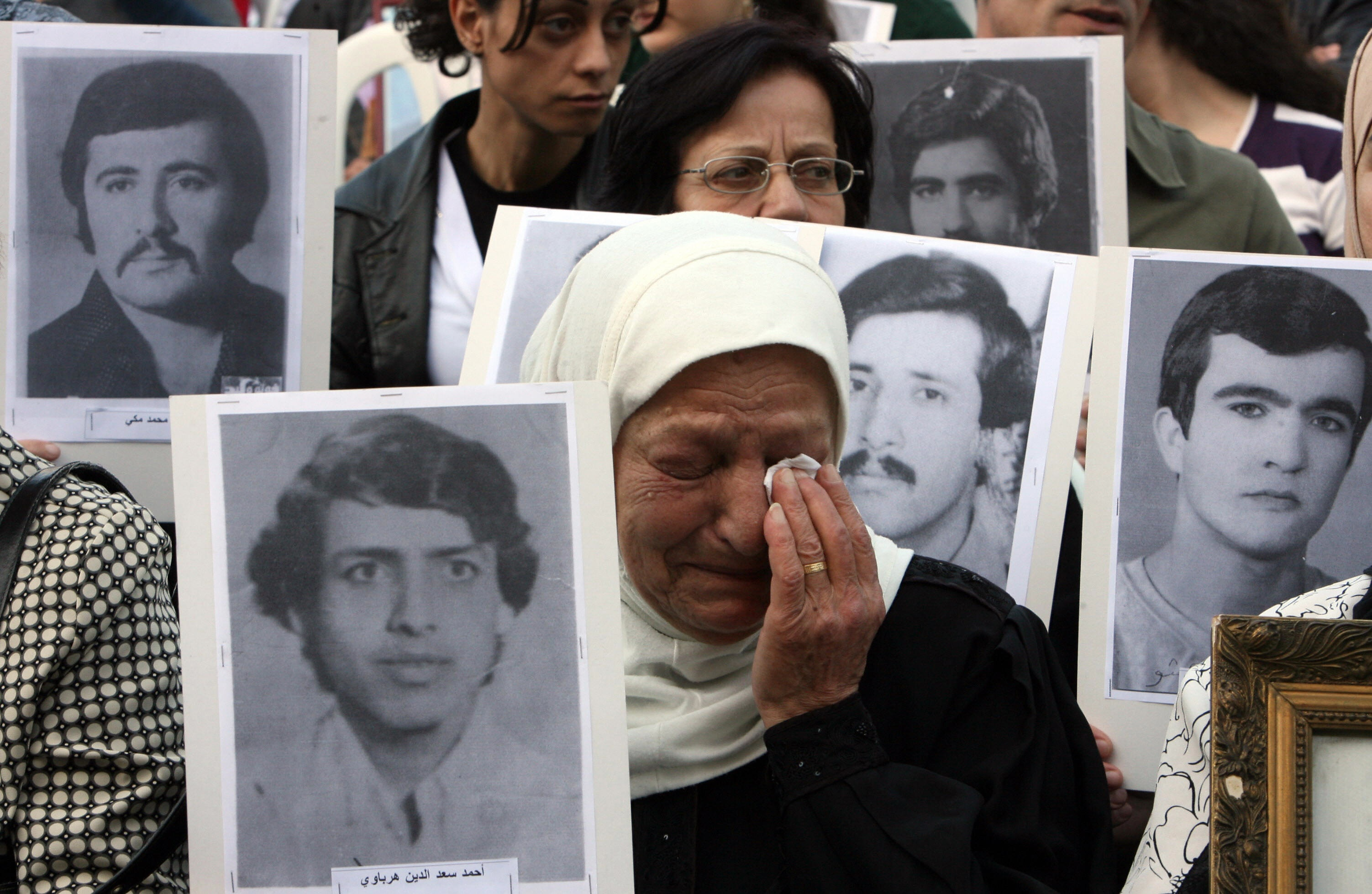 RAMZI HAIDAR/AFP/Getty Images. Relatives of persons missing during the Lebanese civil war gather in Beirut on April 13, 2009, to mark the 34th anniversary of the outbreak of the Lebanese civil war (1975-1990). Over 150,000 were killed during the war, which opened up fault-lines across society that are still evident today.