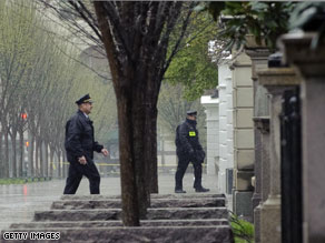 Uniformed members of the Secret Service are seen outside the White House after a suspicious package was tossed over the fence onto the White House grounds.