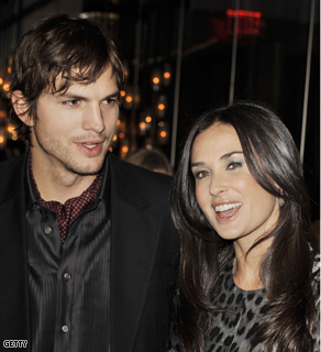 Ashton Kutcher (here with wife, Demi Moore) challenged CNN to a popularity contest.