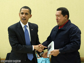 Venezuelan President Hugo Chavez gives a book to President Obama April 18