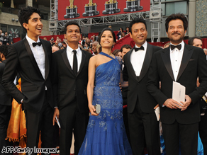 The cast of 'Slumdog Millionaire,' lead actor Dev Patel (L), Freida Pinto (C), Anil Kapoor (R), Irrfan Khan (2nd R), and Madhur Mittal (2nd L) arrive at the 81st Academy Awards on February 22, 2009.