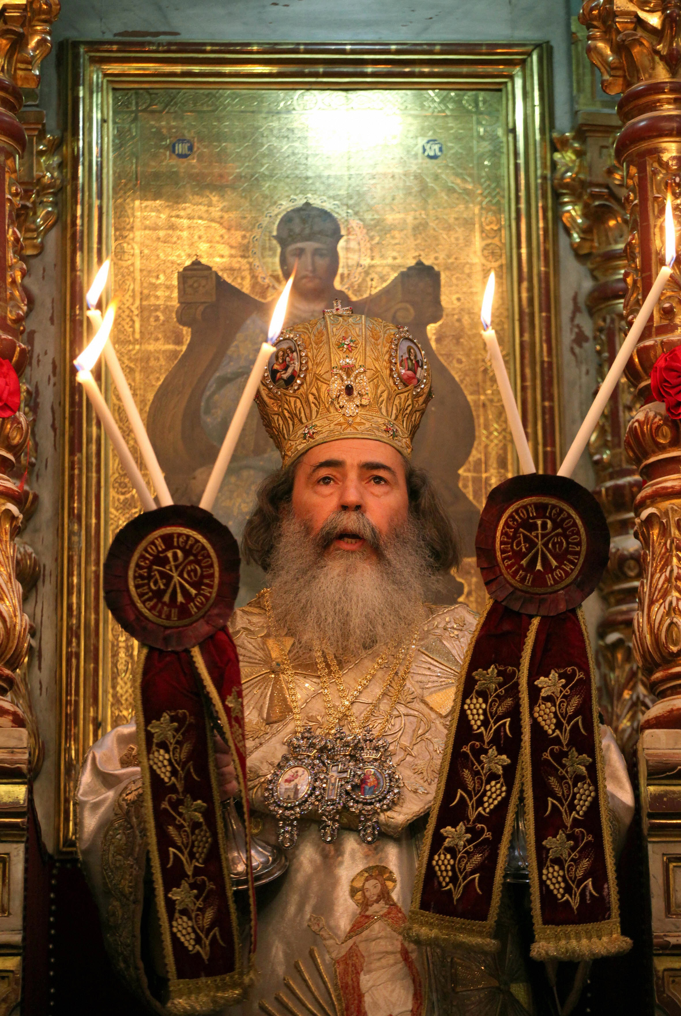 GALI TIBBON/AFP/Getty Images. Greek Orthodox Patriarch of Jerusalem Theophilos III leads the Easter Sunday mass at the Church of the Holy Sepulchre in Jerusalem's Old City on April 19, 2009.