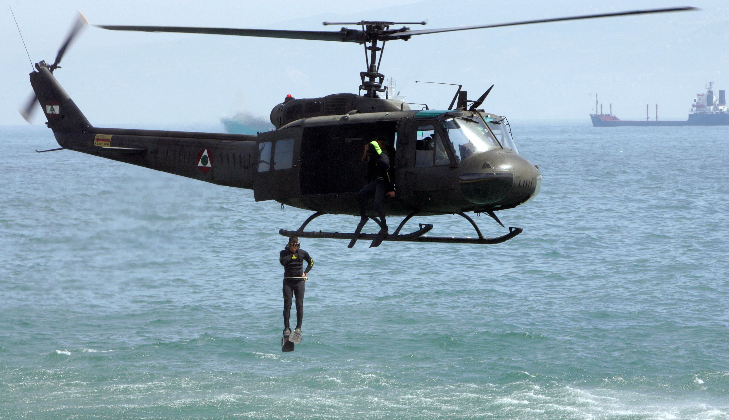 ANWAR AMRO/AFP/Getty Images. A member of the Lebanese Special Forces jumps off a military helicopter as he displays his combat skills at the opening ceremony of the Security Middle East show in Beirut on April 20, 2009.