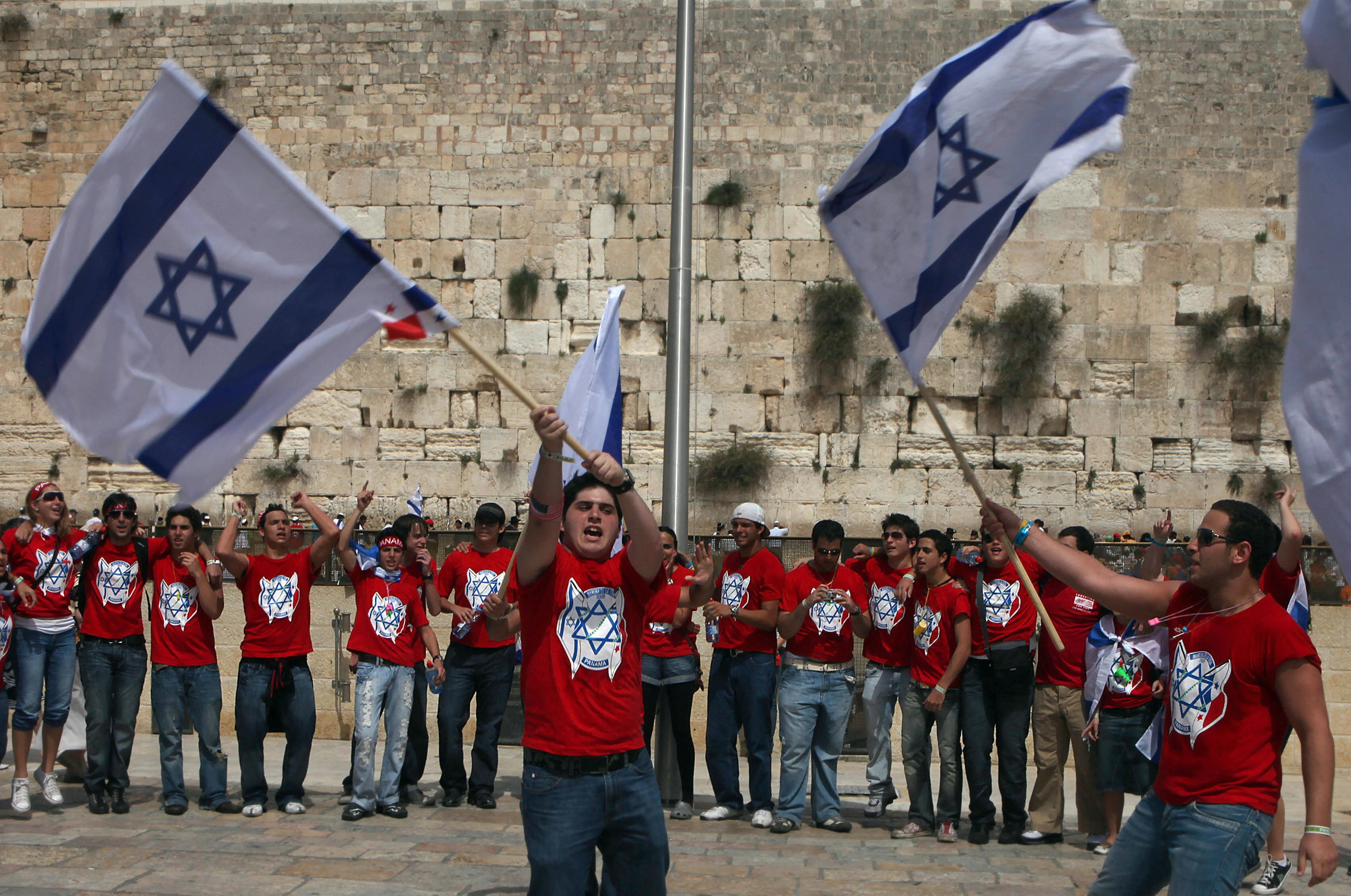 GALI TIBBON/AFP/Getty Images. Jewish youths from communities across the world wave the Israeli national flag at the Western Wall in Jerusalem's Old City, marking Israel's 61st Independence Day on April 29, 2009. Israel today threw a huge birthday bash to celebrate 61 tumultuous years during which the Jewish state made great strides forward but failed to achieve peace with its neighbours.