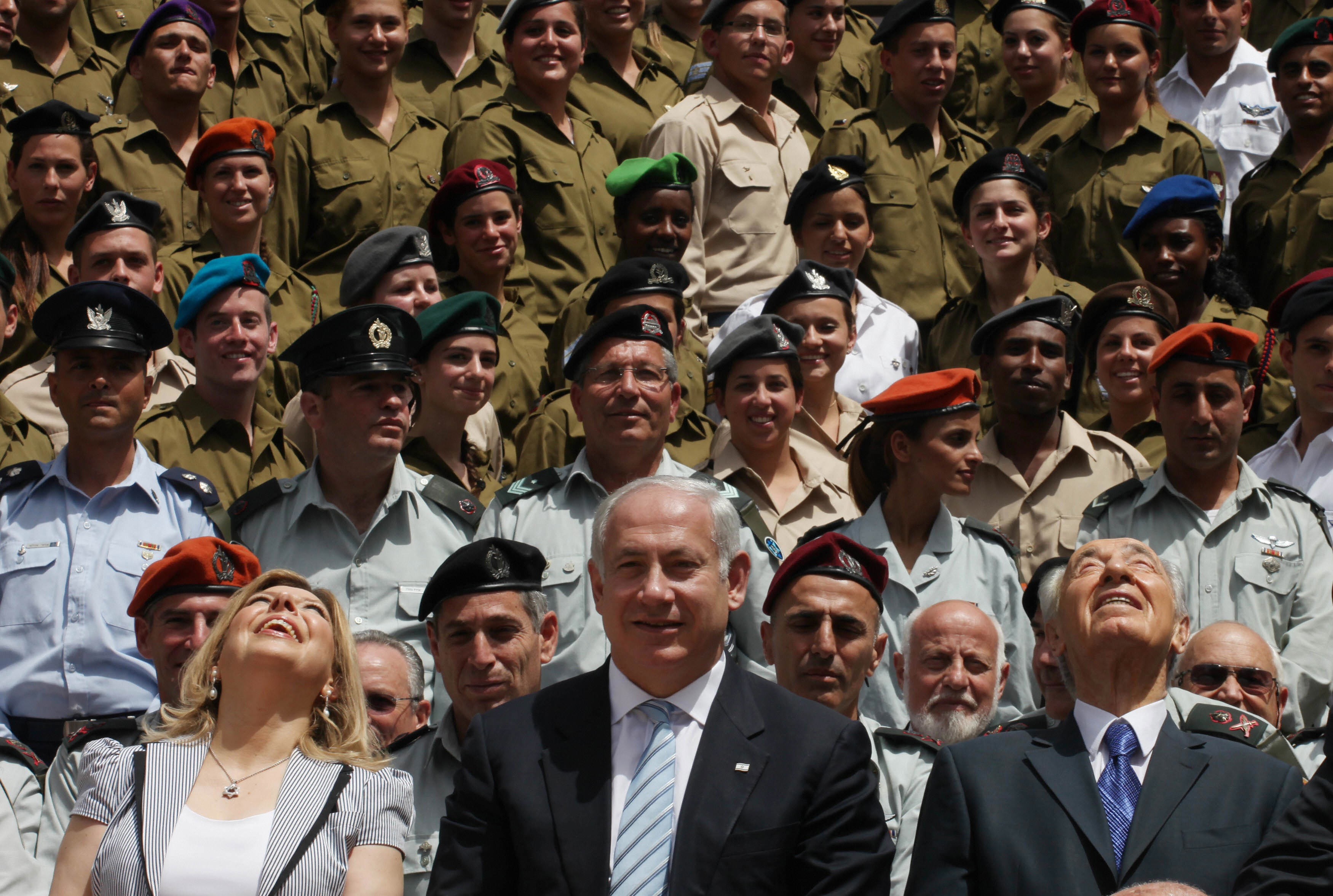 GALI TIBBON/AFP/Getty Images. Israeli Prime Minister Benjamin Netanyahu (C) stands near his wife Sara (L) and President Shimon Peres (R) as they look up at Israeli Air Force fighter jets during a ceremony for outstanding soldiers, part of Independence Day celebrations, on April 29, 2009 in Jerusalem. Israelis marked Independence Day, celebrating the 61st year since the founding of the Jewish State in 1948.
