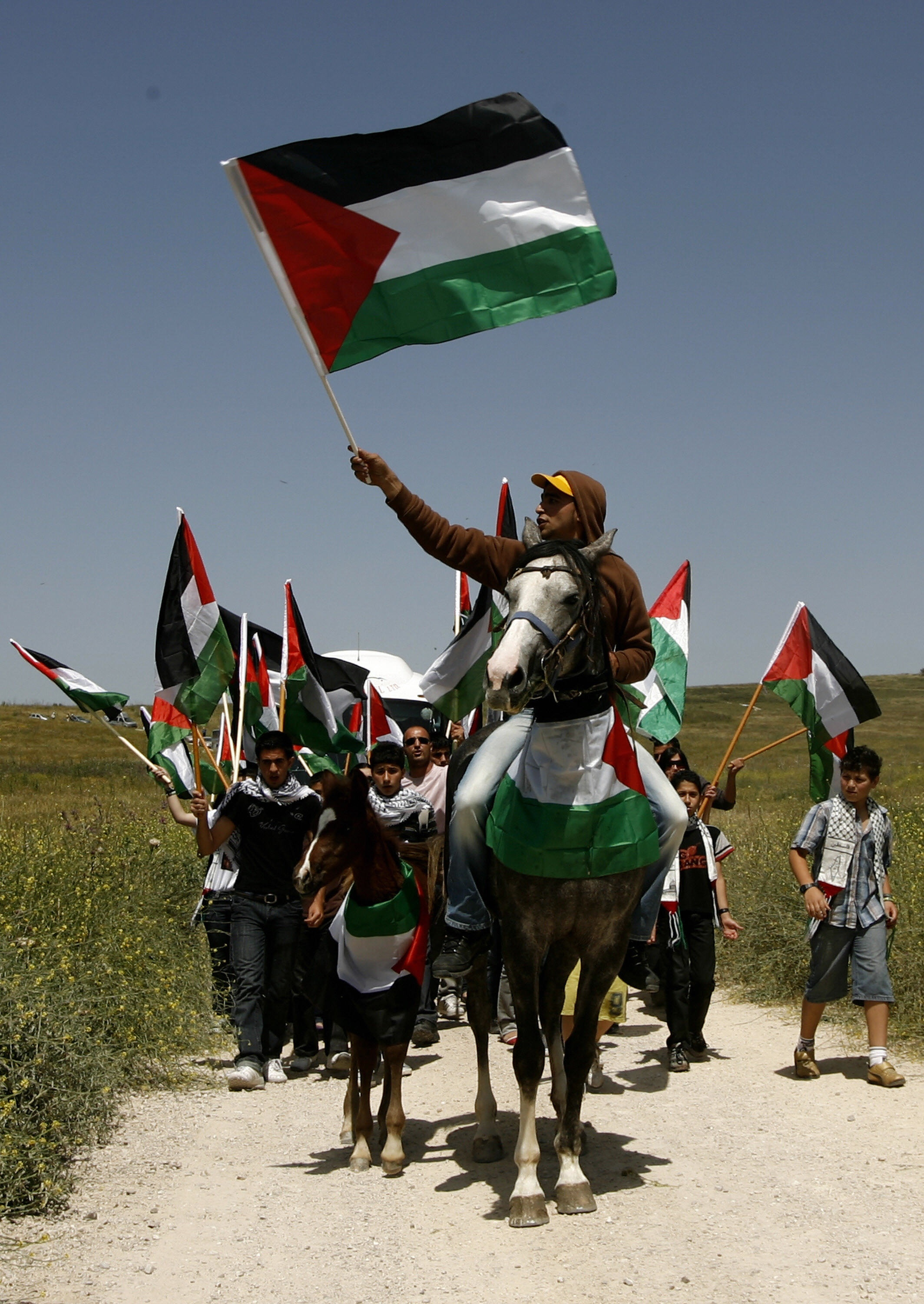 AHMAD GHARABLI/AFP/Getty Images. Arab-Israeli youths, one of them waving a national Palestinian flag, ride horses during a demonstration on April 29, 2009 to demand the right of return to the lands from which they were chased in 1948 on the site of al-Kafrayn, an Arab village among the more than 500 that were razed by Israeli forces at the time of the creation of the Jewish state in 1948.