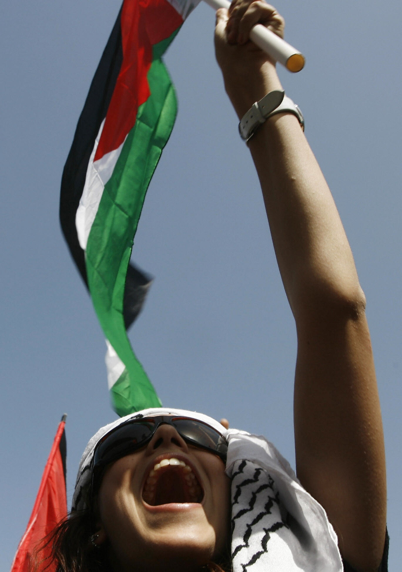 AHMAD GHARABLI/AFP/Getty Images. An Arab-Israeli woman waves a Palestinian flag during a demonstrationg on April 29, 2009 to demand the right of return to the lands from which Palestinians were chased in 1948 on the site of al-Kafrayn, an Arab village among the more than 500 that were razed by Israeli forces at the time of the creation of the Jewish state. As Israel celebrated its 61st anniversary, the demonstrators marched through a small pine forest and the ruins of the village that was torn to the ground on April 19, 1948. Israel has 1.2 million Arab citizens, the descendants of the 160,000 who remained after the creation of the Jewish state while tens of thousands of others fled into exile.