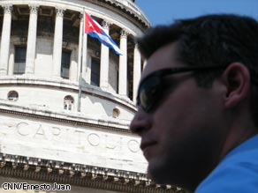 CNN&#039;s Jim Acosta in front of the Cuban Capitol building in Havana, Cuba.