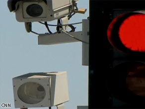 CNN's Carol Costello explores whether traffic light cameras are for safety or profit.