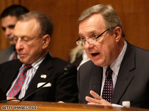 Sen. Durbin, right, is giving up his chairmanship of a subcommittee in favor of Sen. Specter, left.