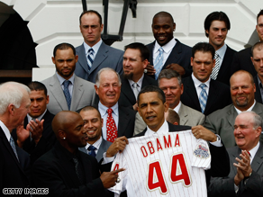 The 2008 World Series Champions posed for photos with Obama after presenting him with a personalized 'Obama 44' jersey.