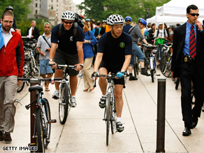 U.S. Secretary of Energy Stephen Chu rides his bicycle to work after he attended a 'Bike to Work Day' event in Washington, DC.