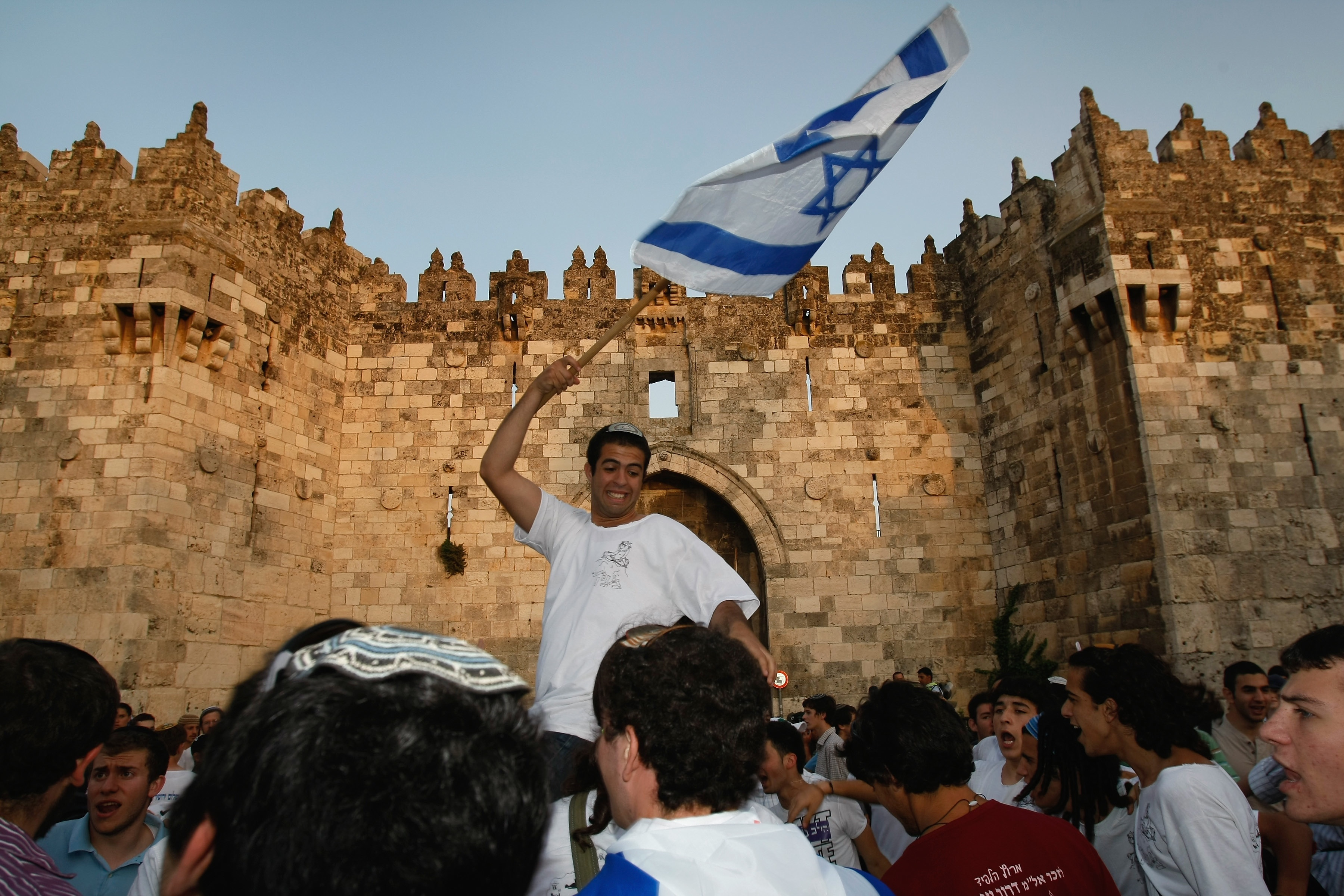 David Silverman/Getty Images. Right-wing religious Israelis dance with their national flag outside the Damascus gate of the Old City on May 21, 2009 in Jerusalem, Israel. Thousands of national religious Jews paraded past the US Consulate towards the Old City and the Western Wall in celebration of Jerusalem Day, the anniversary according to the Hebrew calendar of the city's liberation from Jordanian forces during the 1967 Six Day War.