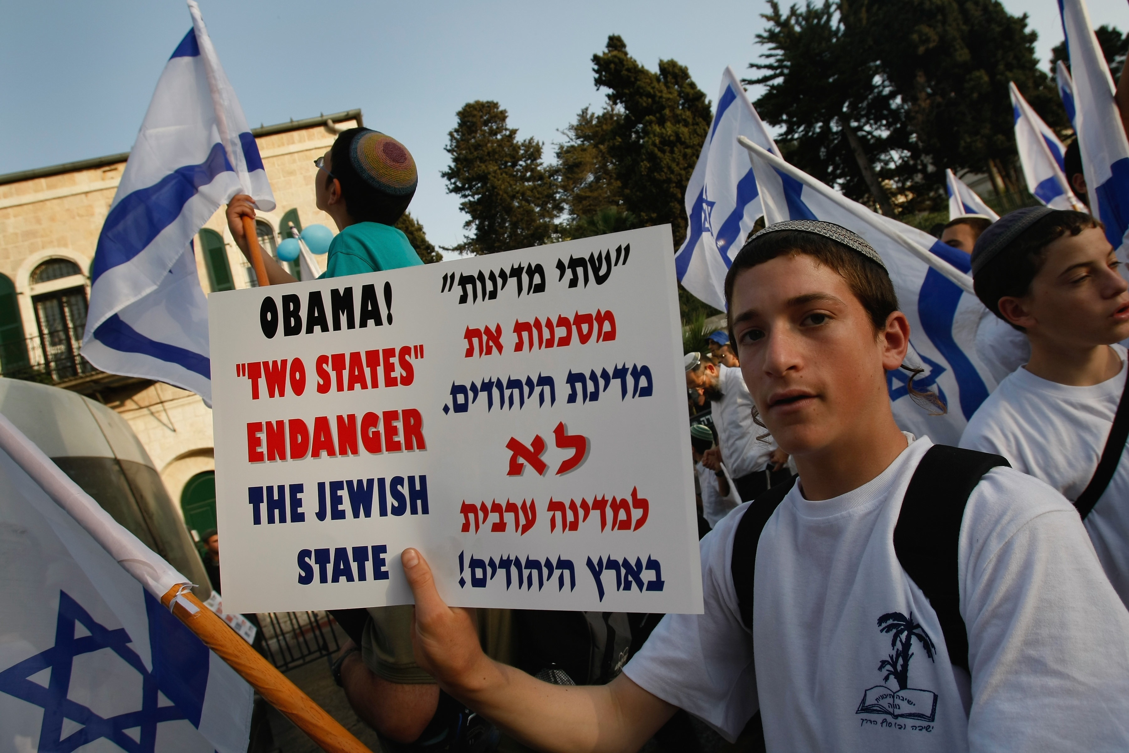David Silverman/Getty Images. A Jewish youth holds up a poster condemning US President Barack Oama's Middle East peace plan as he passes the US Consulate on the way to the Old City on May 21, 2009 in Jerusalem, Israel. Thousands of national religious Jews celebrated Jerusalem Day, the anniversary according to the Hebrew calendar of the city's liberation from Jordanian forces during the 1967 Six Day War.